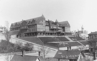 The Rainier Grand Hotel at Marion and First Streets and the Rainier Hotel, pictured here, served as Seattle's main tourist hotels. In 1892, Frank LaRoche took this photograph of the Rainier Hotel on Fifth Avenue between Marion and Columbia Streets. The Rainier was a large, framed building high atop the residential and commercial districts. After 1893's Wall Street panic, the hotel's linens were transferred to the Rainier Grand on First Avenue, and the Rainier Hotel was converted into the Rainier Apartments. It was never a financial success as it was too far away from the financial district, and it was razed in 1910.