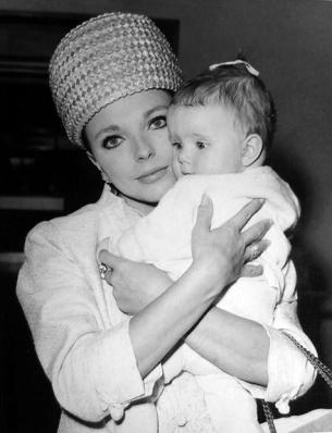 Joan Collins and daughter Tara at London Airport. November, 1964