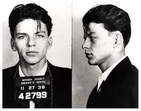 """BERGEN COUNTY, NJ - 1938: Pop singer Frank Sinatra poses for a mug shot after being arrested and charged with """"carrying on with a married woman"""" in 1938 in Bergen County, New Jersey. (Photo by Michael Ochs Archives/Getty Images)"""