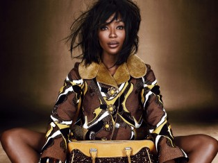 Naomi Campbell Louis Vuitton acrylic and wool jacquard coat and embellished wool and calfskin bag, Cartier at Siegelson vintage 14k gold, citrine, and diamond ring and bracelet, Salvatore Ferragamo heels *** Local Caption *** Naomi Campbell;